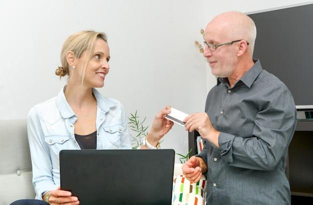 Mature couple e-shopping on internet