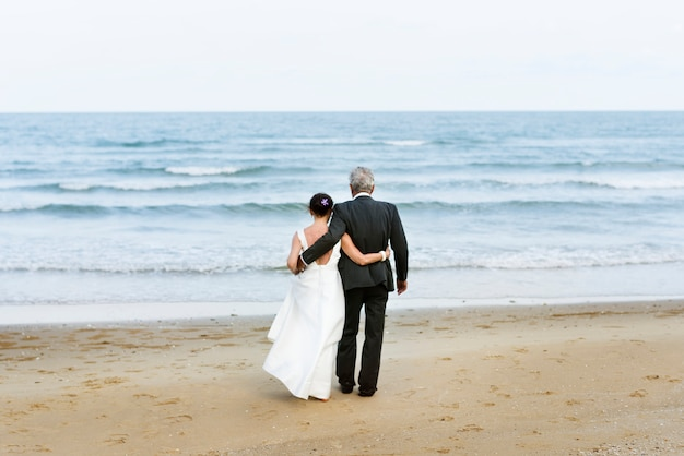Mature couple getting married at the beach