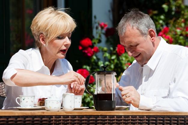 Mature couple having coffee outdoor