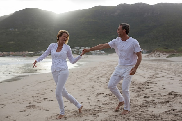 Mature couple having fun together at beach
