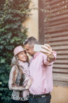 Mature couple in love doing a self-portrait