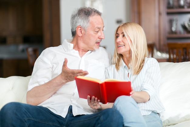 Mature couple reading a book together
