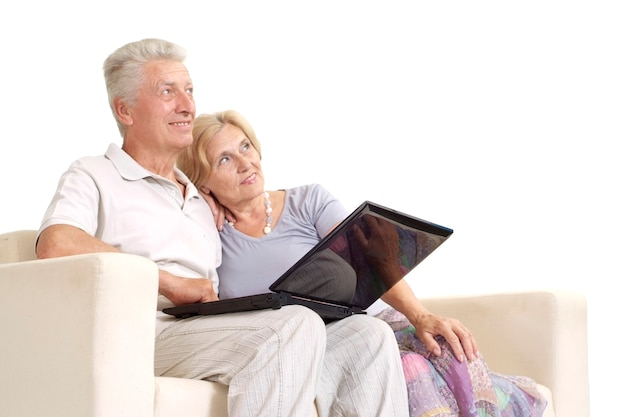 Mature couple relaxing at home on a white
