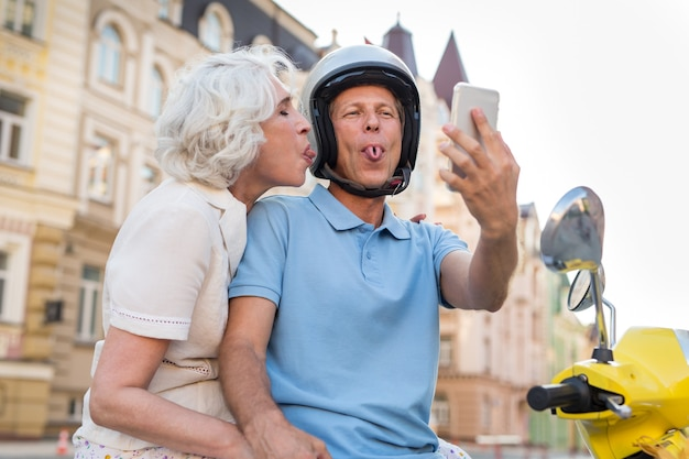 Mature couple showing tongues.