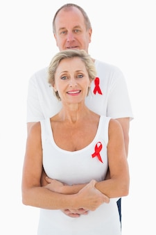 Mature couple supporting aids awareness together