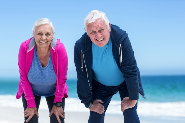 Mature couple tired after running