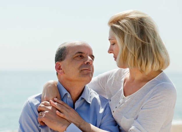 Mature couple together at sea