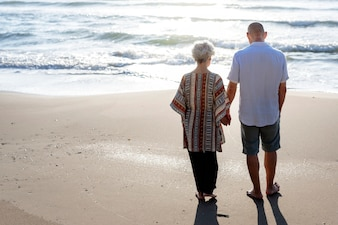 Mature couple walking together at the beach
