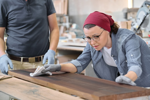 Mature craftswoman working in woodshop