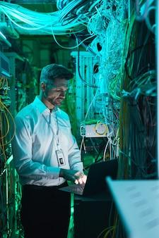 Mature engineer setting up network