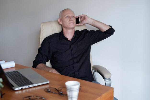 Mature entrepreneur talking on phone