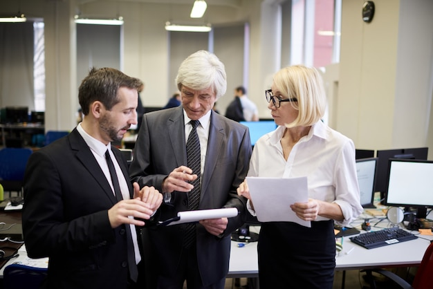 Mature executives in office
