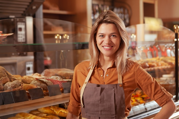 Mature female baker working at her bakery store