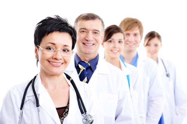 Mature female doctor with group of happy successsful colleagues