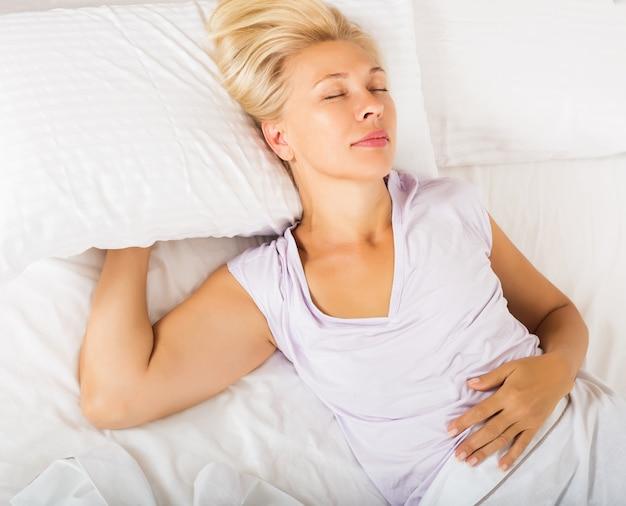 Mature female in pijamas sleeping