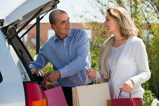 Mature husband and wife with shopping bags