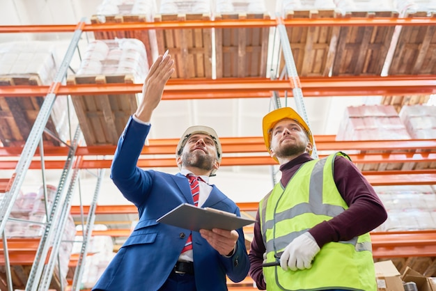 Mature investor talking to worker
