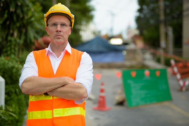Mature man construction worker at the construction site