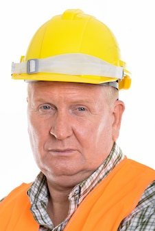 Mature man construction worker isolated against white wall
