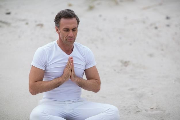 Mature man doing meditation