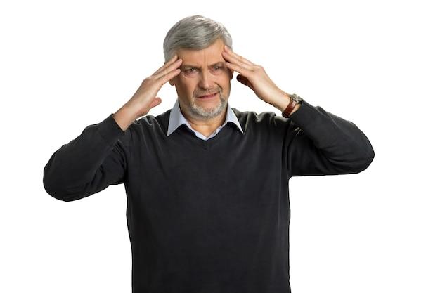 Mature man getting headache, white. tired senior man have a terrible headache. overworked elderly enterpreneur have migraine.
