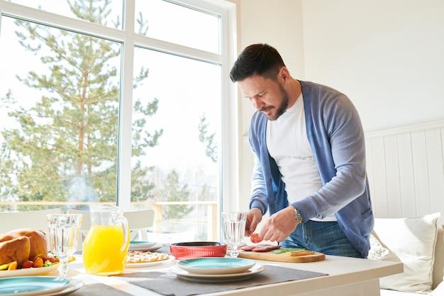 Mature man preparing dinner