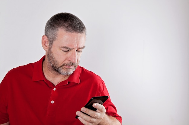 Mature man searching for information in cell phone