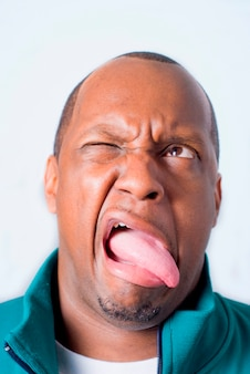 Mature man sticking out tongue