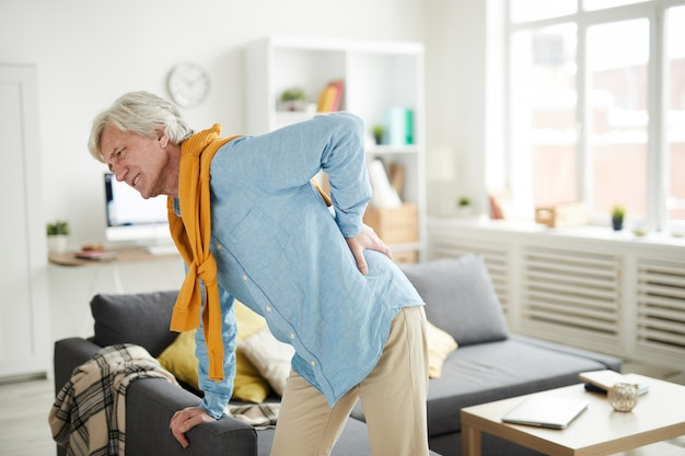 Mature man suffering from back pain