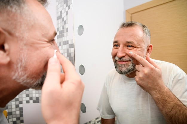 Mature man taking care of his skin