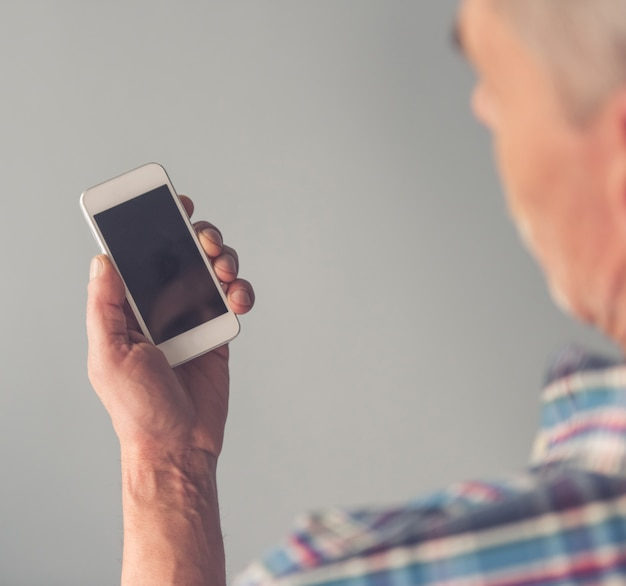 Mature man using a smartphone