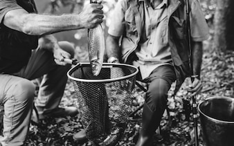 Mature man with a freshly caught fish