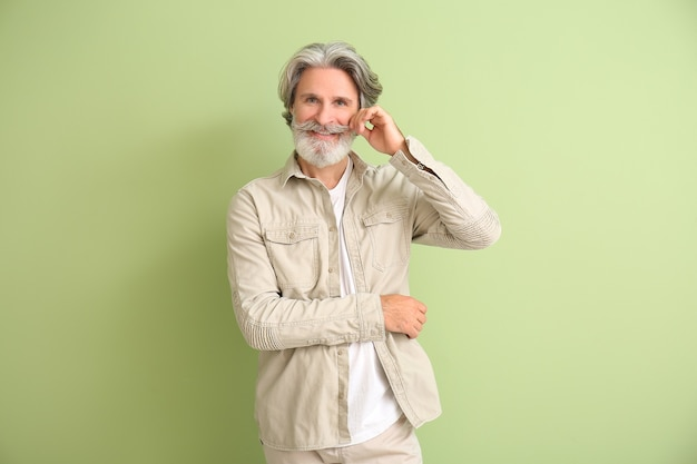 Mature man with grey hair on color