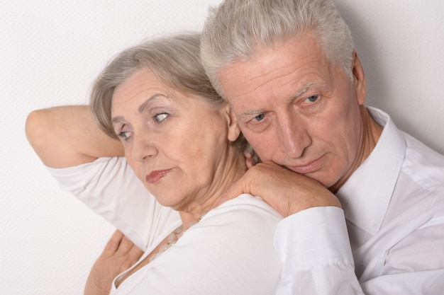 Mature man with woman isolated on white background