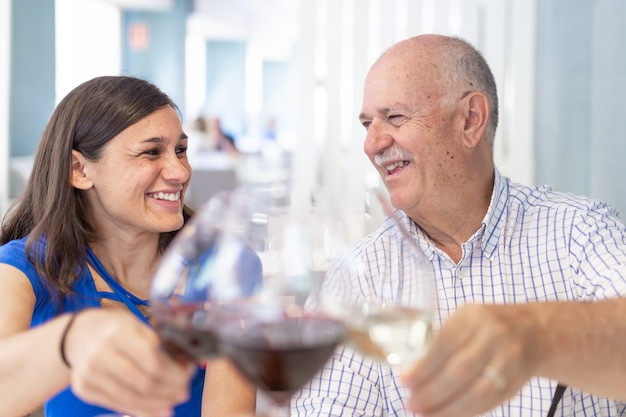 Mature man and young woman enjoying and smiling, spending time together