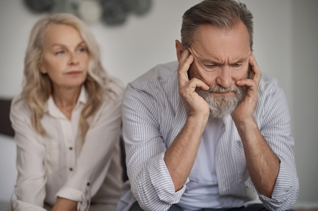 Mature married couple keeping silence after an argument