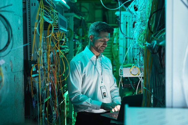 Mature network engineer setting up network