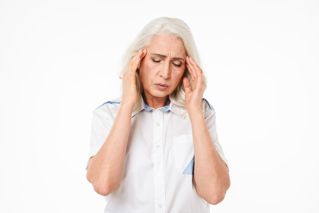 Mature old woman with headache.