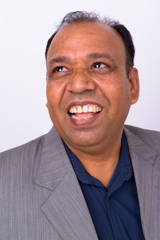 Mature overweight indian businessman in suit with receding hairline on white