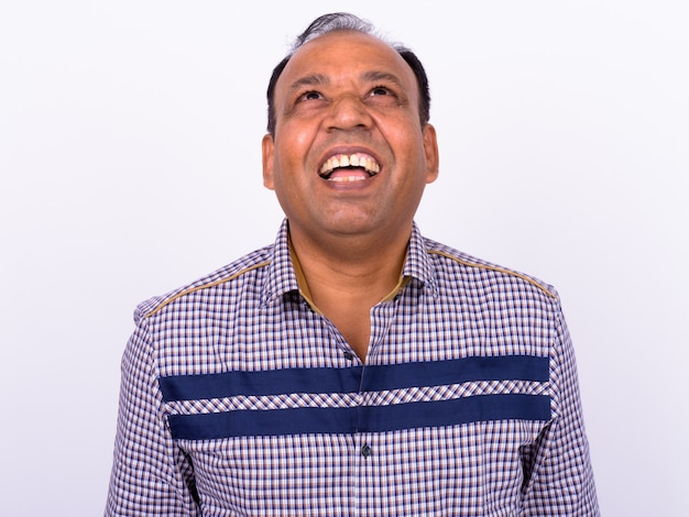 Mature overweight indian businessman with receding hairline on white
