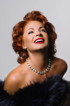Mature redhead woman in image of marilyn monroe