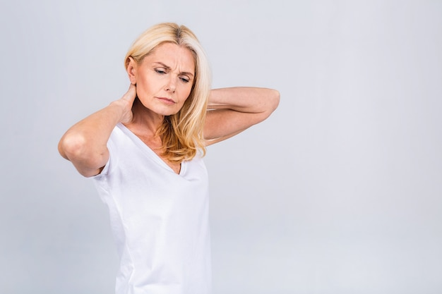 Mature senior old beautiful woman wearing casual suffering from back pain. empty blank copy space with backache concept. isolated over white grey background