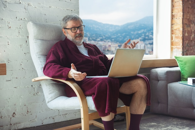 Mature senior older man during quarantine, realizing how important stay at home during virus outbreak