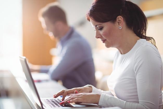 Mature student using laptop