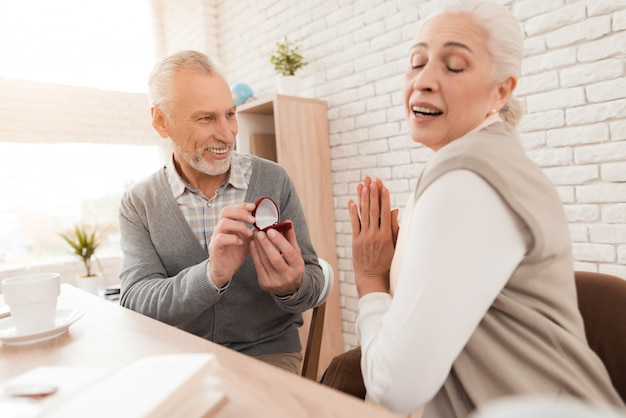 Mature woman admires act of older man.