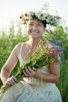 Mature  woman in camomile wreath
