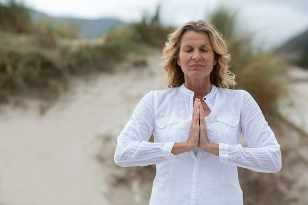 Mature woman doing meditation