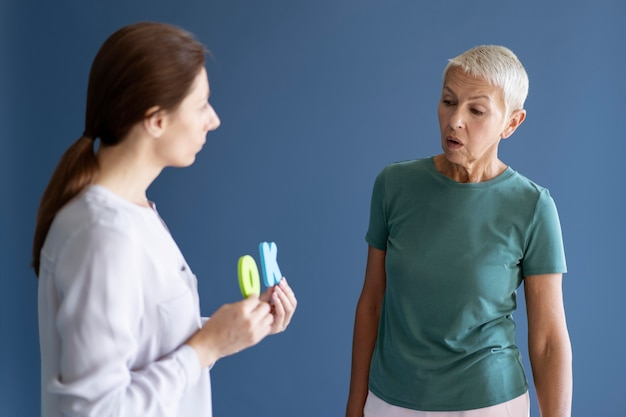 Mature woman doing an occupational therapy session with a psychologist