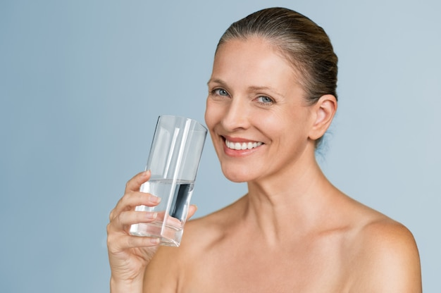 Mature woman drinking water