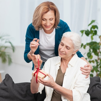 Mature woman giving her friend a present